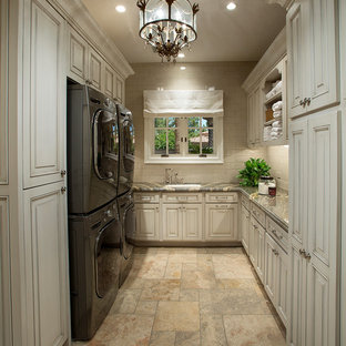 Dedicated laundry room - huge transitional u-shaped porcelain floor dedicated laundry room idea in Phoenix with flat-panel cabinets, granite countertops, a side-by-side washer/dryer, beige cabinets and an undermount sink