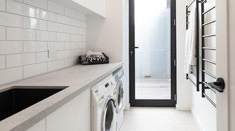 Laundry with black towel racks