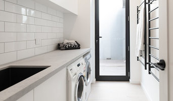 Laundry with black towel racks