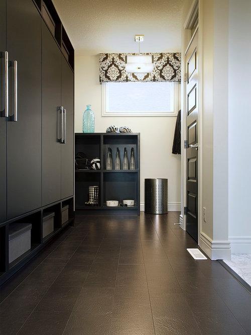 ... flat-panel cabinets, gray cabinets, wood countertops and black walls