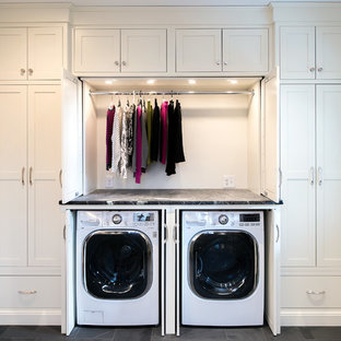 Large traditional single-wall utility room in Other with shaker cabinets, white cabinets, soapstone worktops, slate flooring, a concealed washer and dryer, grey worktops and grey walls.