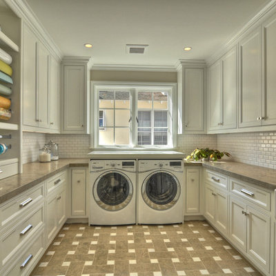 Example of a classic laundry room design in Orange County with a farmhouse sink and white cabinets