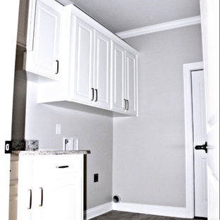 Photo of a large contemporary galley utility room in New Orleans with flat-panel cabinets, white cabinets, granite worktops, grey walls, ceramic flooring, white floors and yellow worktops.