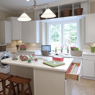 Inspiration for a timeless laundry room remodel in St Louis with white cabinets