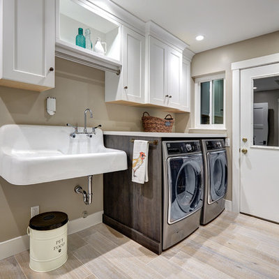 Example of a mid-sized cottage porcelain tile and beige floor laundry room design in Sacramento with an utility sink, recessed-panel cabinets, white cabinets, quartz countertops, beige walls and a side-by-side washer/dryer