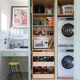 Eclectic multicolored floor utility room photo in Los Angeles with a stacked washer/dryer
