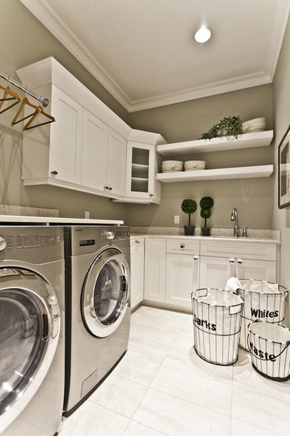 transitional laundry room by Marcson Homes Ltd.