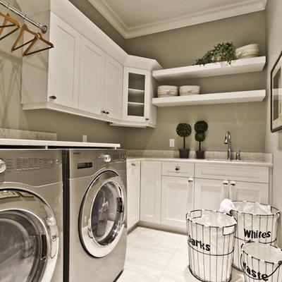 Elegant laundry room photo in Edmonton with gray walls