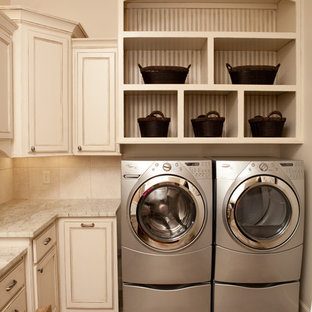 Inspiration for a large classic u-shaped separated utility room in Dallas with beaded cabinets, white cabinets, granite worktops, white walls, vinyl flooring, a side by side washer and dryer, multi-coloured floors and multicoloured worktops.