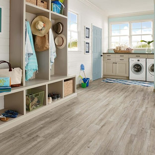 Large classic utility room in San Francisco with open cabinets, light wood cabinets, white walls, vinyl flooring, a side by side washer and dryer and grey floors.