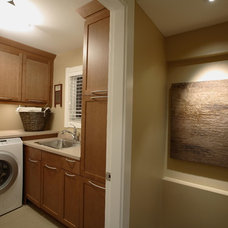 Transitional Laundry Room by Synthesis Design Inc.