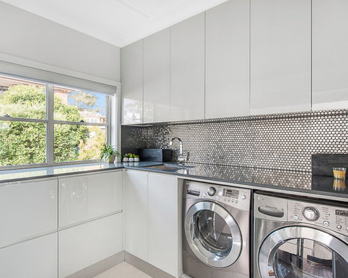 photo of a contemporary dedicated laundry room in newcastle maitland with white cabinets granite - Laundry Design Ideas