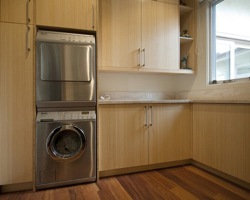 inspiration for a laundry room remodel in los angeles with a stacked washerdryer