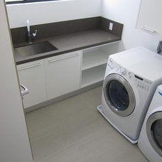Modern Laundry Room by Classic Tile and Mosaic