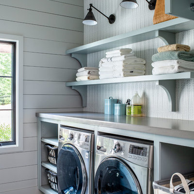 Example of a farmhouse gray floor laundry room design in Atlanta with open cabinets, blue cabinets, gray walls, a side-by-side washer/dryer and gray countertops