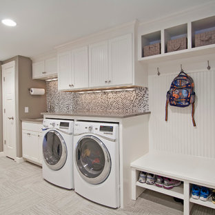 Utility room - large traditional single-wall ceramic floor and gray floor utility room idea in Minneapolis with white cabinets, an undermount sink, shaker cabinets, solid surface countertops, beige countertops and gray walls