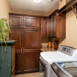 Small southwest u-shaped ceramic floor and beige floor dedicated laundry room photo in Phoenix with raised-panel cabinets, granite countertops, beige walls, multicolored countertops and dark wood cabinets