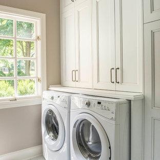 Idéer för en liten klassisk vita parallell tvättstuga enbart för tvätt, med en undermonterad diskho, luckor med infälld panel, vita skåp, beige väggar, marmorgolv, en tvättmaskin och torktumlare bredvid varandra och vitt golv