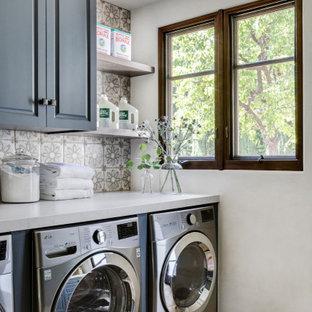 Laundry room - mediterranean laundry room idea in Orange County