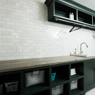 Mid-sized elegant galley marble floor and white floor dedicated laundry room photo in Indianapolis with a drop-in sink, shaker cabinets, green cabinets, wood countertops, green walls and a side-by-side washer/dryer