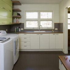 Midcentury Laundry Room by Brennan + Company Architects