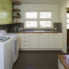 modern laundry room by Brennan + Company Architects