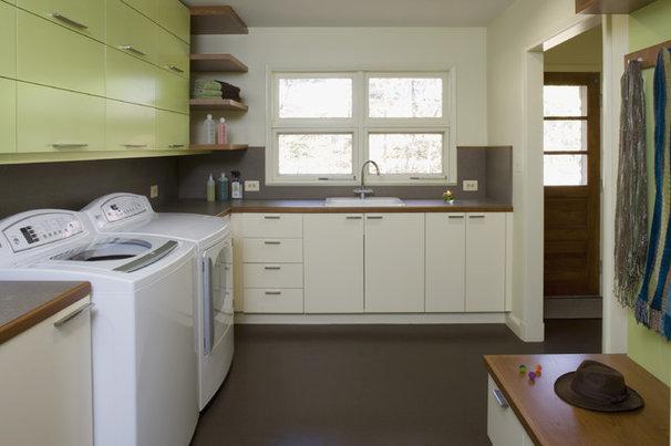 Midcentury Laundry Room by Brennan + Company Architects
