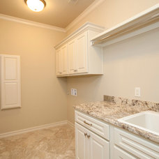 Traditional Laundry Room by Insight Homes, Inc.