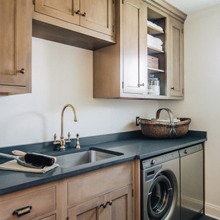 Design ideas for a mid-sized arts and crafts single-wall laundry room in New York with an undermount sink, quartz benchtops, white walls, a side-by-side washer and dryer, slate floors, grey benchtop, recessed-panel cabinets and medium wood cabinets.