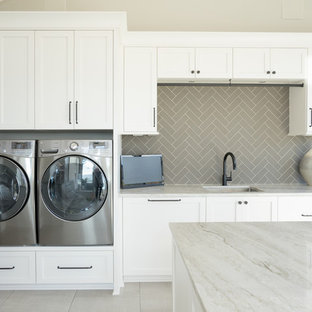 Utility room - transitional ceramic tile and gray floor utility room idea in Other with an undermount sink, shaker cabinets, white cabinets, marble countertops, beige walls, a side-by-side washer/dryer and green countertops