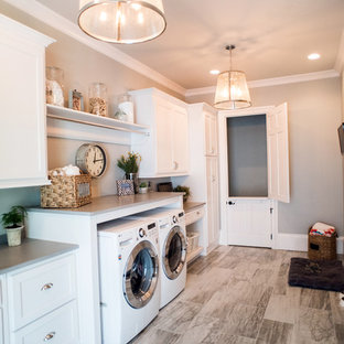 Photo of a large traditional laundry room in Atlanta with plywood floors and grey walls.