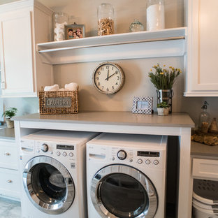 Design ideas for a large classic separated utility room in Atlanta with a submerged sink, white cabinets, engineered stone countertops, grey walls, porcelain flooring, a side by side washer and dryer and recessed-panel cabinets.
