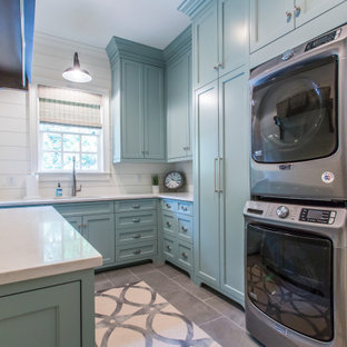 Inspiration for a country ceramic tile and gray floor laundry room remodel in Atlanta with shaker cabinets, turquoise cabinets, white walls, a stacked washer/dryer and white countertops