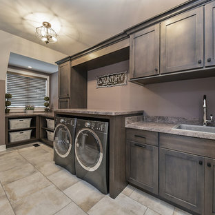Large classic single-wall separated utility room in Chicago with a built-in sink, shaker cabinets, dark wood cabinets, laminate countertops, purple walls, porcelain flooring and a side by side washer and dryer.