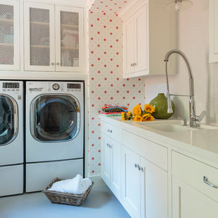 Photo of a mid-sized country u-shaped dedicated laundry room in Los Angeles with an undermount sink, shaker cabinets, white cabinets, red walls, porcelain floors and a side-by-side washer and dryer.
