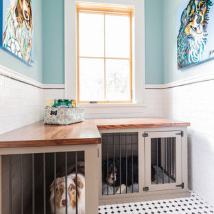 Inspiration for a large farmhouse l-shaped separated utility room in Houston with a submerged sink, shaker cabinets, black cabinets, granite worktops, blue walls, ceramic flooring, a side by side washer and dryer, multi-coloured floors and black worktops.