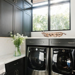 Inspiration for a small country l-shaped dedicated laundry room remodel in Salt Lake City with black cabinets, marble countertops, white walls, a side-by-side washer/dryer and multicolored countertops