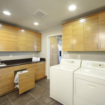 Example of a trendy laundry room design in Sacramento with gray walls and medium tone wood cabinets