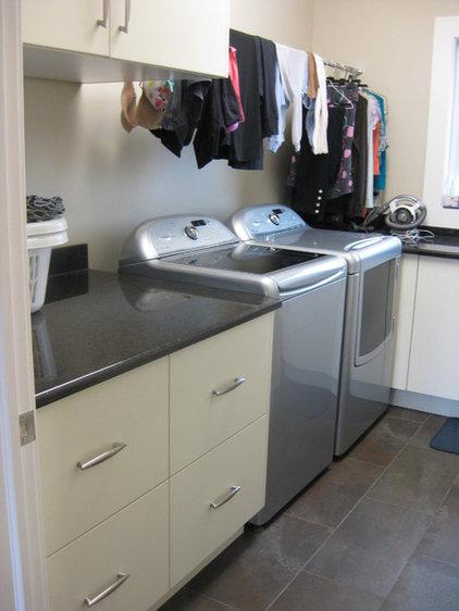 Modern Laundry Room by Fran Loga - Redl Kitchens