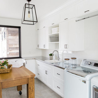 Transitional laundry room photo in Salt Lake City with a drop-in sink, white cabinets, stainless steel countertops, white walls and shaker cabinets