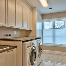 Traditional Laundry Room by CONSTRUCTEUR GENERAL LC INC