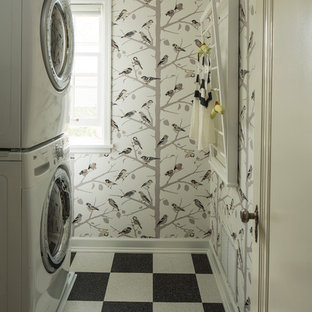 Laundry room - eclectic multicolored floor laundry room idea in Minneapolis with a stacked washer/dryer