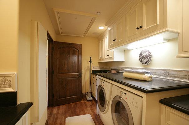Mediterranean Laundry Room by Conrado - Home Builders