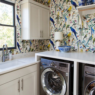 Dedicated laundry room - transitional l-shaped multicolored floor and wallpaper dedicated laundry room idea in Raleigh with an undermount sink, shaker cabinets, white cabinets, multicolored backsplash, multicolored walls, a side-by-side washer/dryer and white countertops