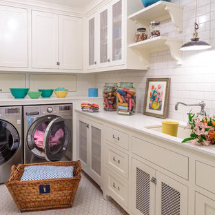 This is an example of a large country l-shaped separated utility room in Los Angeles with a submerged sink, shaker cabinets, white cabinets, engineered stone countertops, ceramic flooring, a side by side washer and dryer, white worktops, white walls and grey floors.