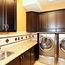 Rustic Laundry Room by Wolf Custom Homes Ltd.
