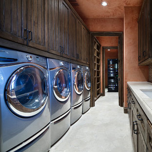 Huge tuscan galley beige floor dedicated laundry room photo in Houston with an undermount sink, recessed-panel cabinets, dark wood cabinets, a side-by-side washer/dryer and beige countertops