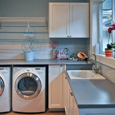 Contemporary Laundry Room by Synthesis Design Inc.