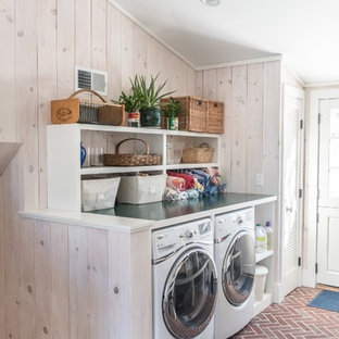 Mudroom/laundry with brick floor