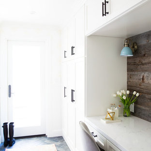Example of a classic single-wall porcelain tile and black floor laundry room design in San Francisco with an undermount sink, shaker cabinets, white cabinets, quartz countertops, white walls, a side-by-side washer/dryer and white countertops